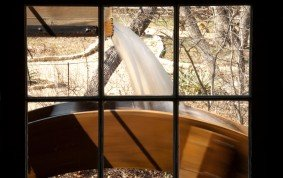 The Water Wheel Turns a Drive Shaft